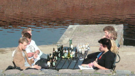 Teens drinking on a summer day.